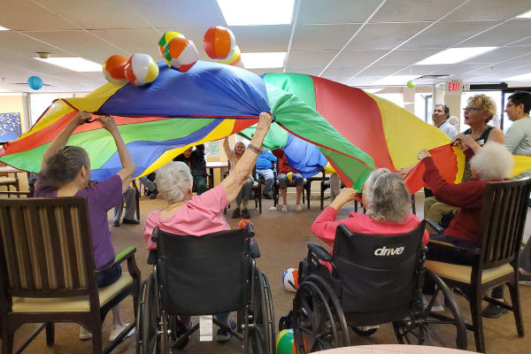 Residents playing games at Woodland Palms Memory Care