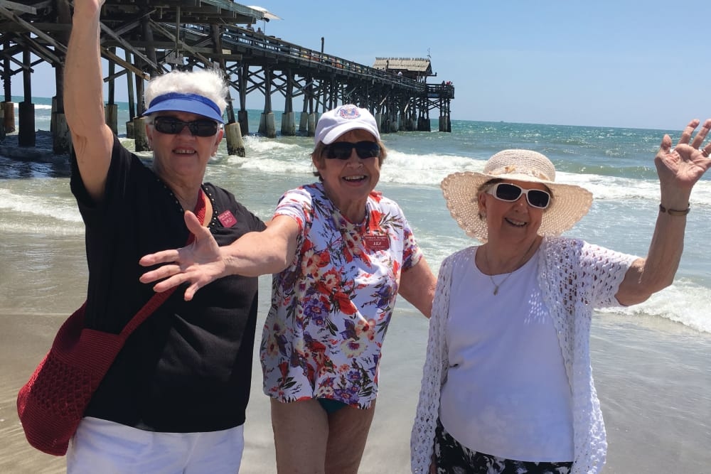 3 Senior women from Hawthorn Senior Living in Vancouver, Washington standing on a beach posing for a picture