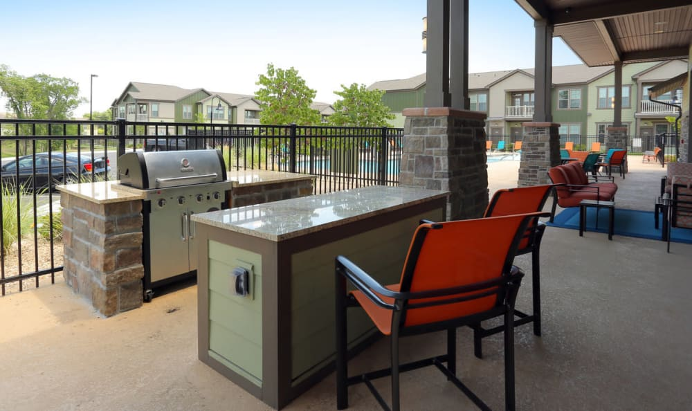 Outdoor Seating Area At Springs at Woodlands South Apartments In Tulsa