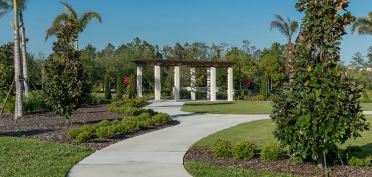 Beautiful landscaping and walking paths at Merrill Gardens at ChampionsGate