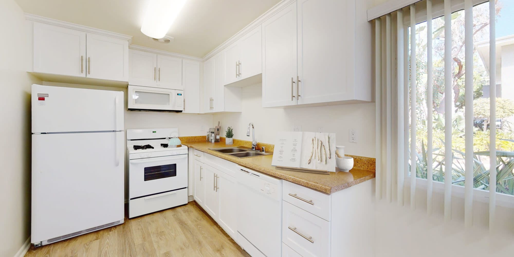 Open kitchen of a two bedroom apartment at West Park Village in Los Angeles, California