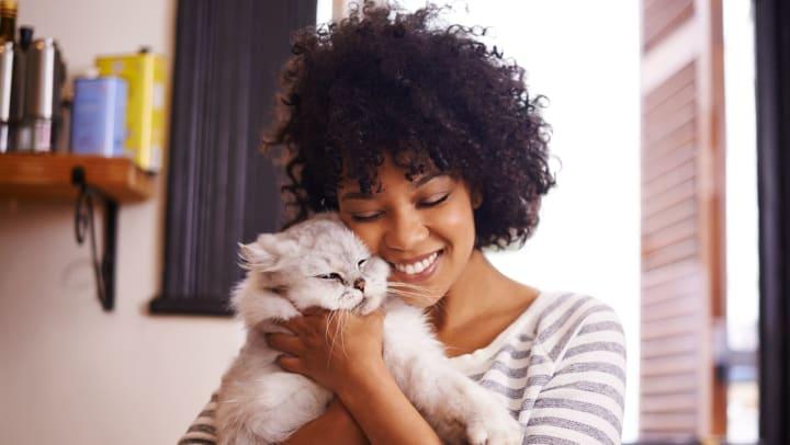 Woman hugs a cat