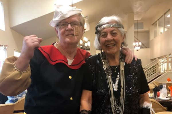 Two residents dressed up at Heritage Meadows Gracious Retirement Living in Cambridge, Ontario