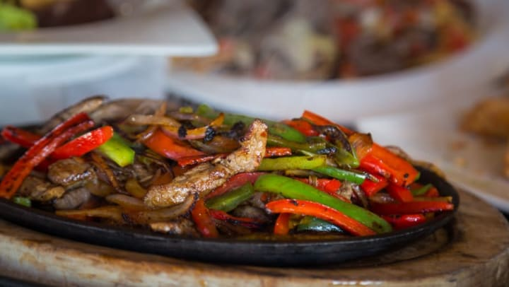 Plate of fajitas at a local Mexican restaurant near Olympus Midtown in Nashville, Tennessee