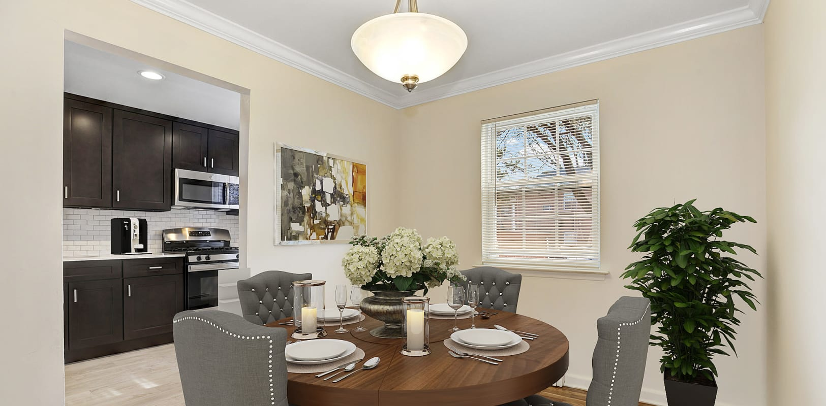 Dining room and large kitchen with new appliances at Park Lane Apartments in Little Falls, New Jersey
