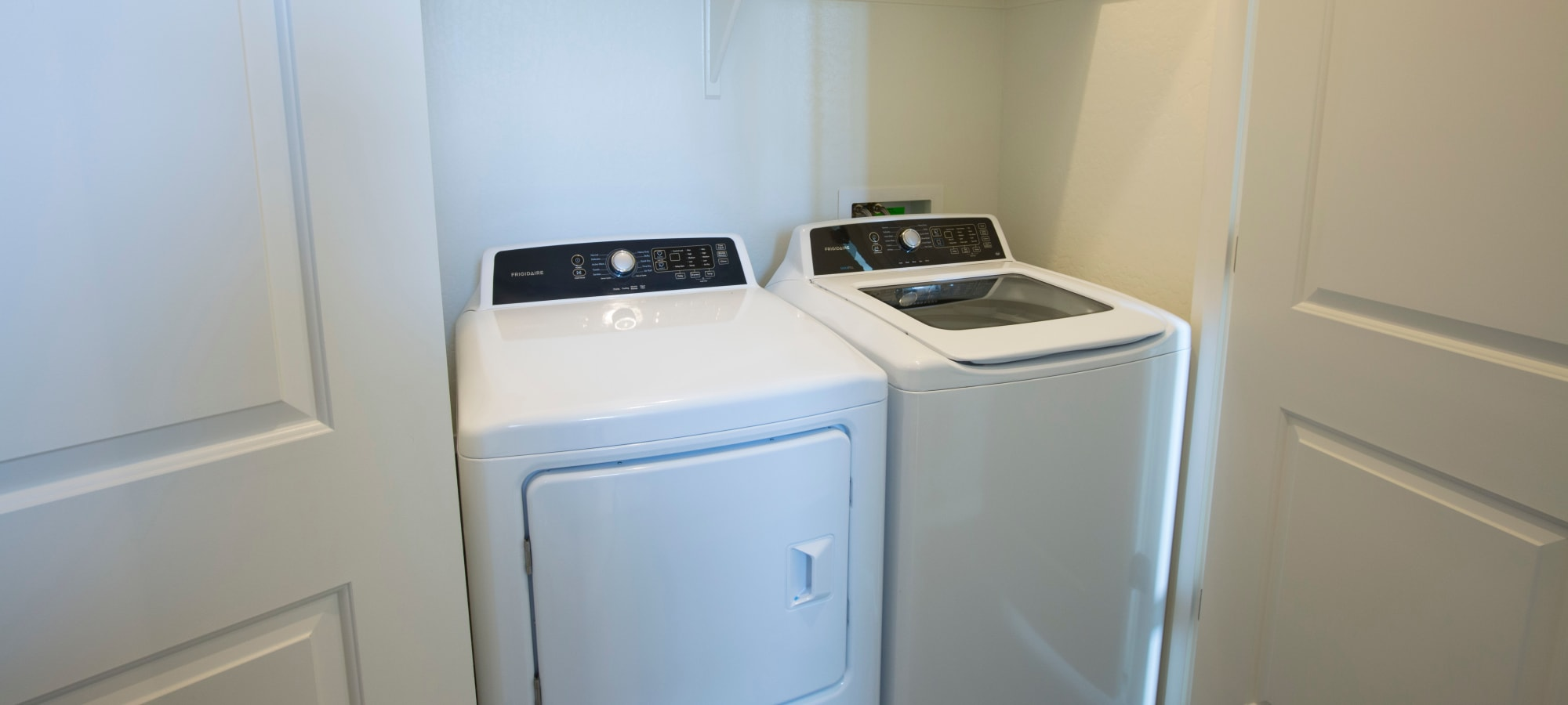 In-unit washer and dryer in a model home at Christopher Todd Communities On Happy Valley in Peoria, Arizona