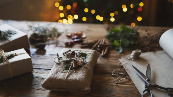 Gift wrapping on a wooden coffee table