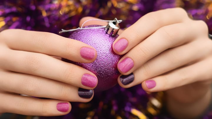 Beautiful pink and purple sparkly festive nails
