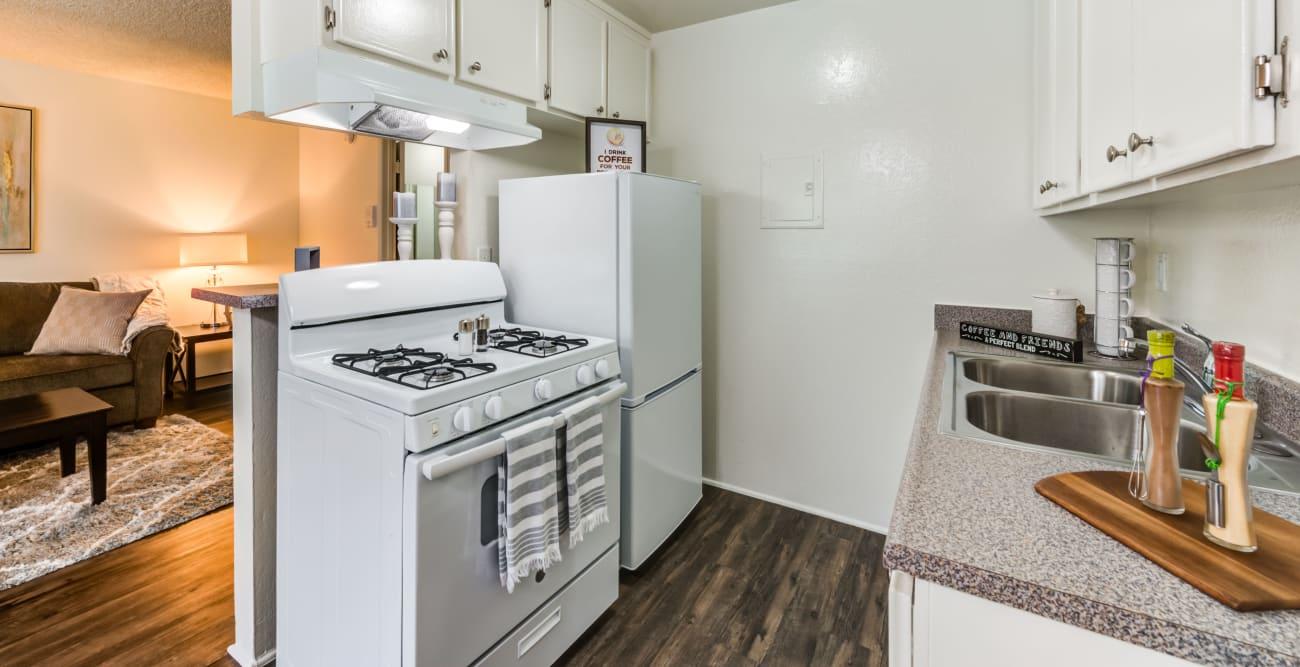 Bright kitchen overlooking living area at The Esplanade in Lake Balboa, California