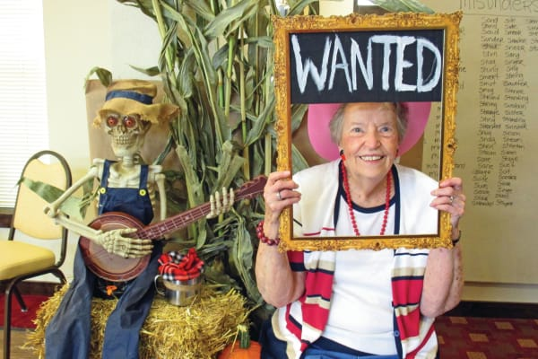 A resident with a photo prop at Somerset Assisted Living in Gladstone, Oregon