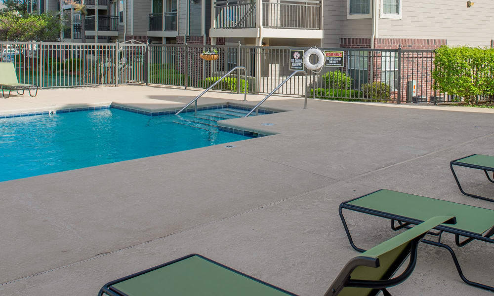 Poolside seating at Crown Pointe Apartments in Oklahoma City, Oklahoma