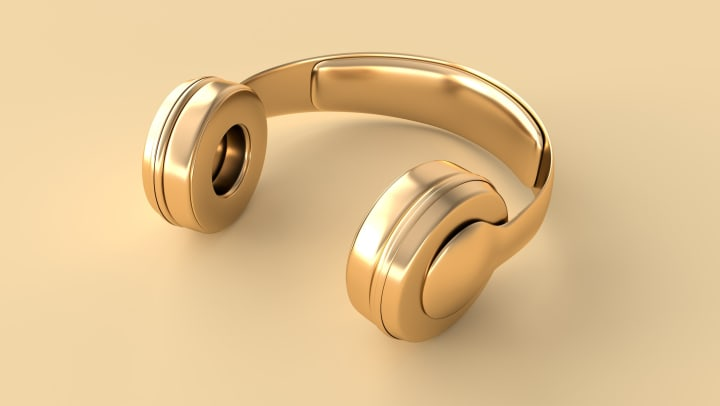 Gold headphones on gold background