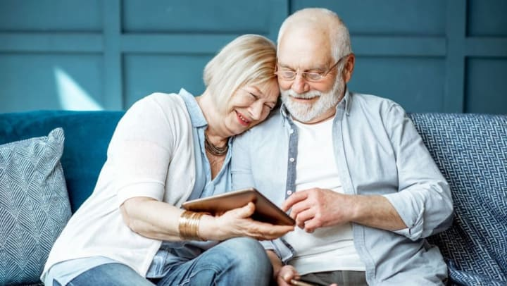 Happy couple using video sharing together