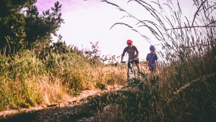 Residents mountain biking near Wimberly at Deerwood in Jacksonville, Florida
