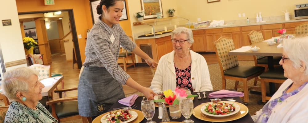 Residents being served food in dinning room at The Springs at Sunnyview in Salem, Oregon