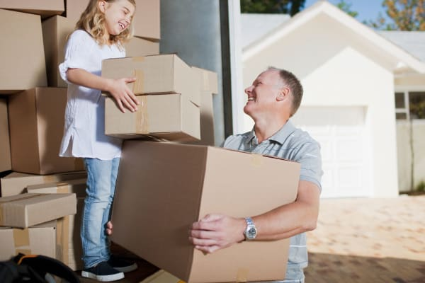 Family using packing supplies from Midgard Self Storage in Mulberry, Florida