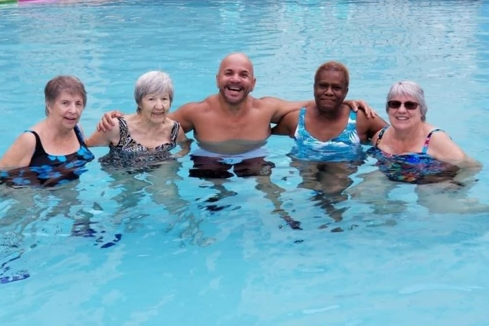 group of senior residents in the pool