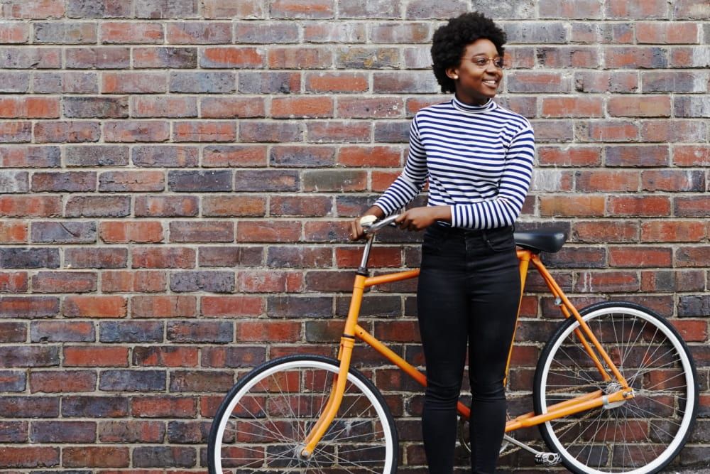 Resident riding bike near Clarendon House in Sacramento, California