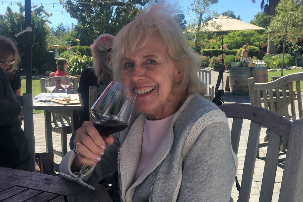 Resident enjoying wine tasting at Merrill Gardens at Monterey