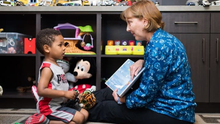 Counselor reading to a young child