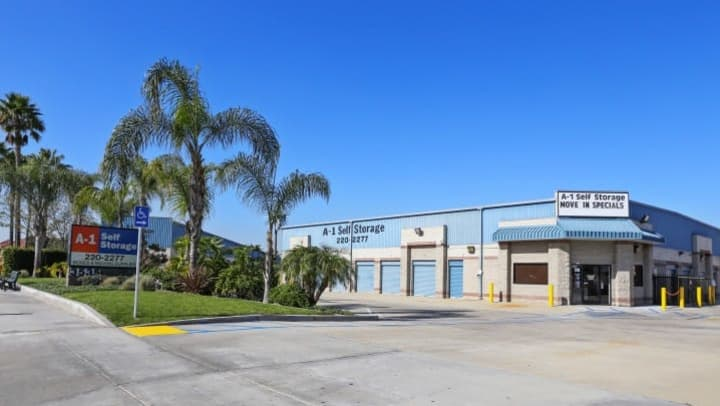 The front office for A-1 Self Storage in Anaheim is covered by several palm trees and other beautiful vegetation.