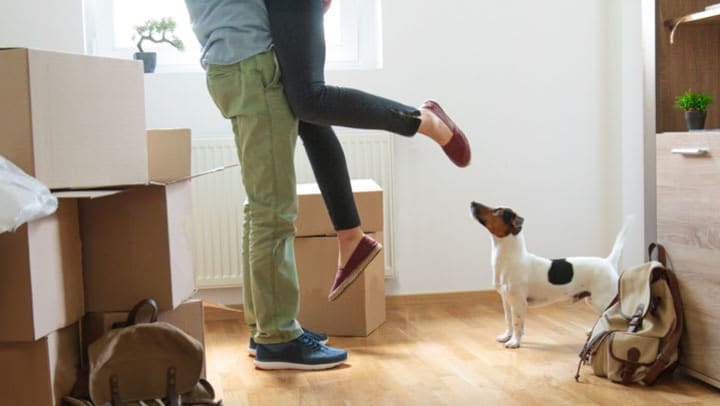 Couple taking a break from packing stuff in boxes