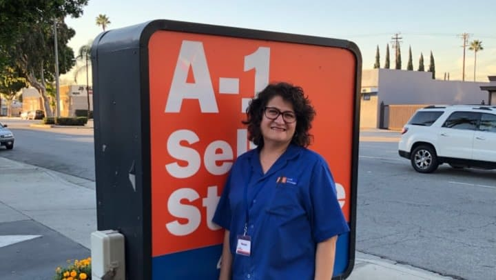 Susan standing in front of the street sign at A-1 Self Storage in El Monte, California.