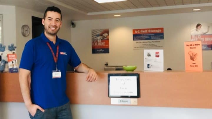 Edson poses in front of the desk at A-1 Self Storage in Chula Vista, CA.