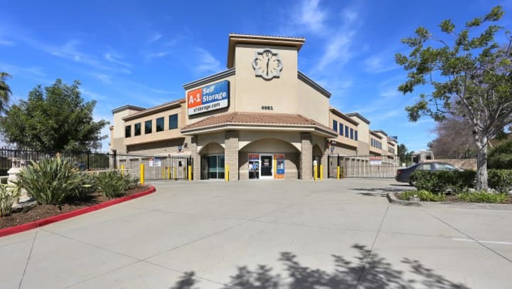A view up to the front entrance of A-1 Self Storage on Spring St in La Mesa, CA, including the clock above the front office.