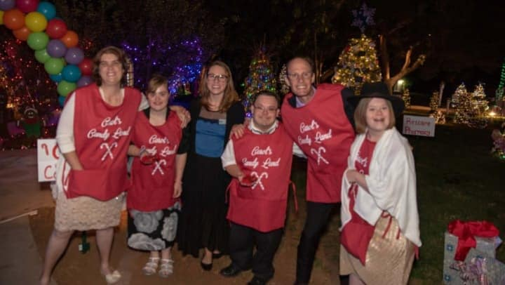Participants at the Enchanted Village pose for a photo.