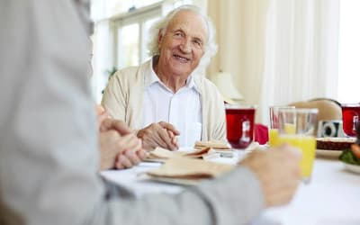Resident enjoying his meal at Mattison Crossing at Manalapan Avenue in Freehold, New Jersey