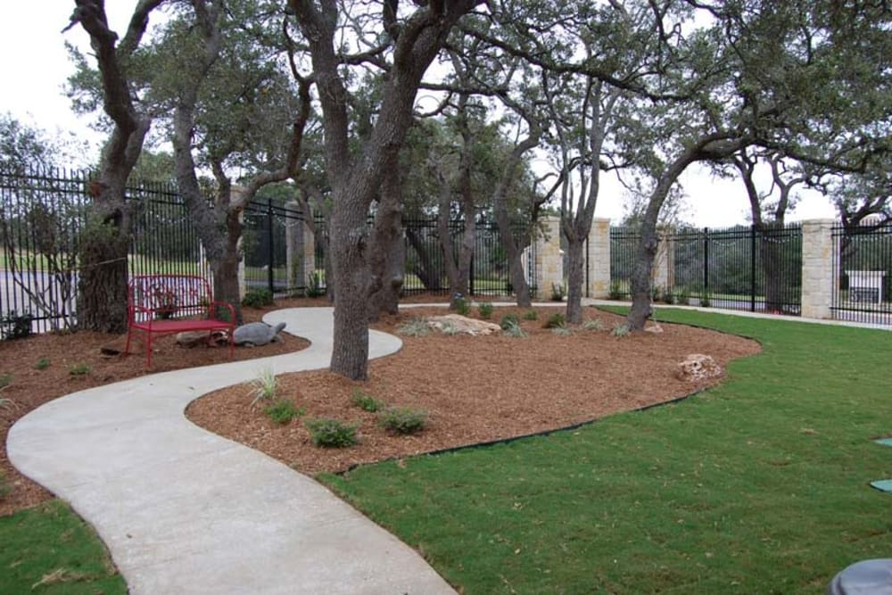 A paved walkway around the courtyard at Autumn Grove Cottage at Stone Oak in San Antonio, Texas