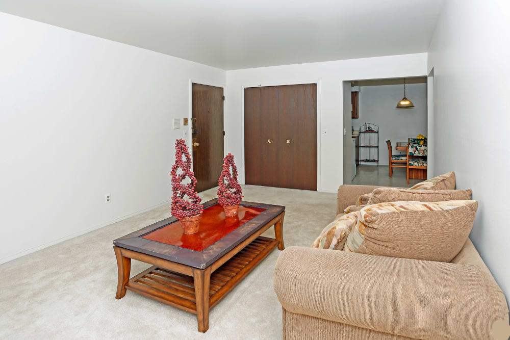 Enjoy beautiful living room at Utica Square Apartments in Roseville, Michigan