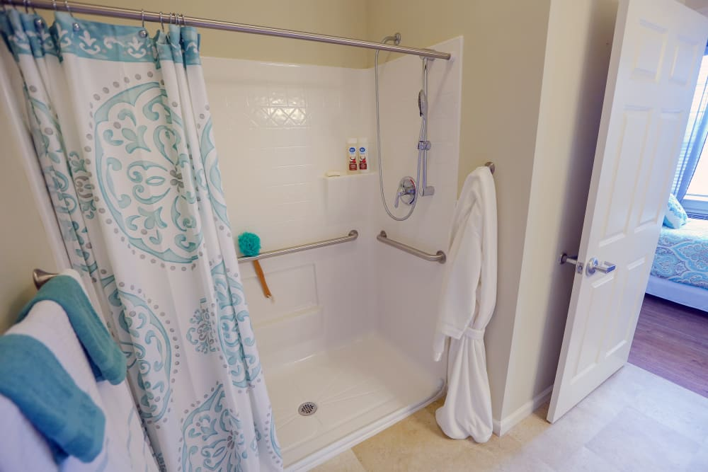 A bathroom with a walk-in shower at Harmony at Chantilly in Herndon, Virginia