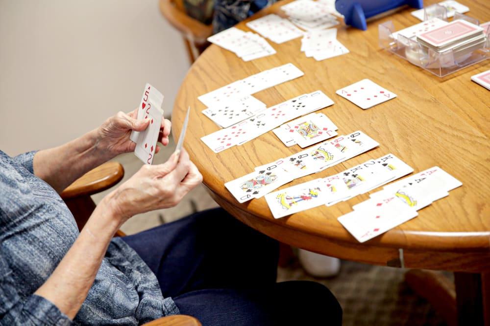 Residents playing cards at Providence Assisted Living in Clarksville, Arkansas.