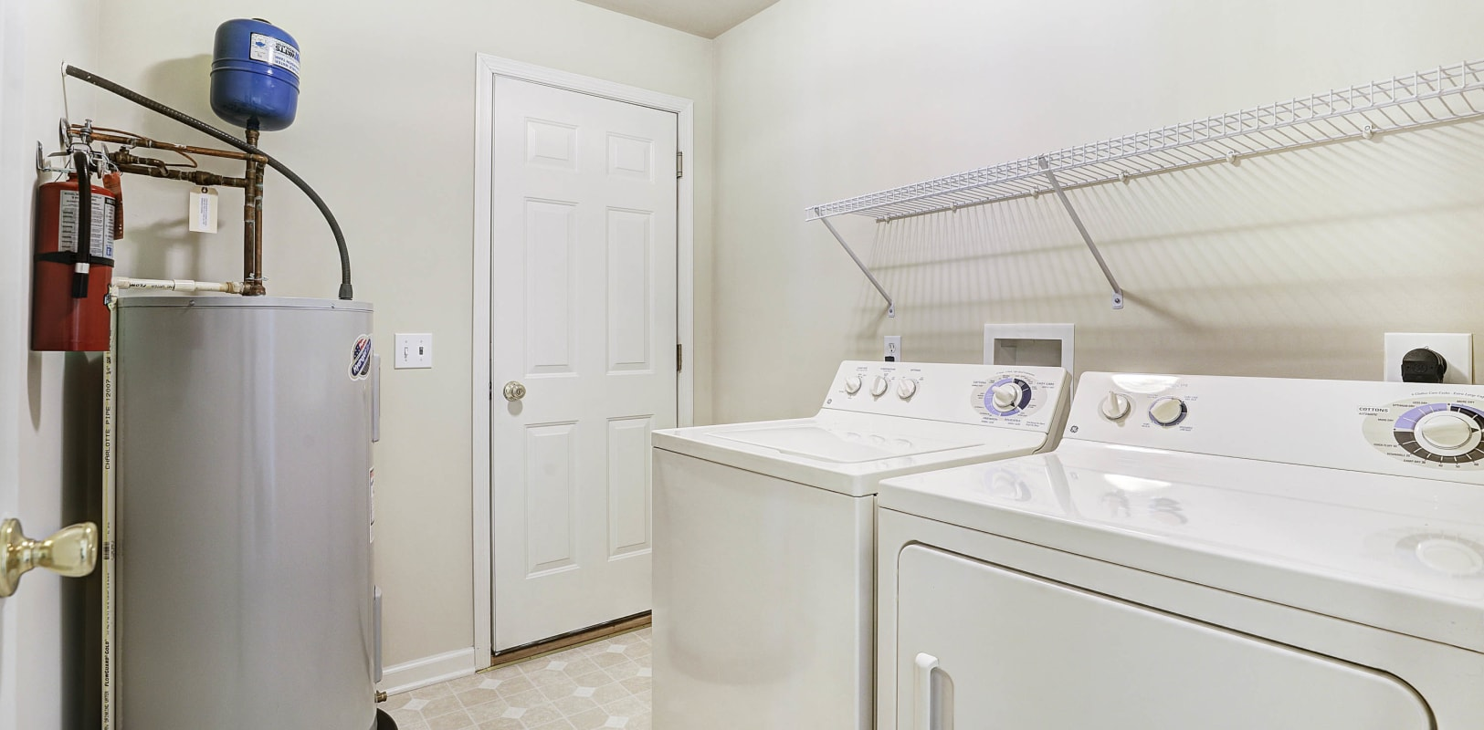Full-size in-unit washer and dryer and water heater in a model home's laundry room at Hanover Glen in Bethlehem, Pennsylvania