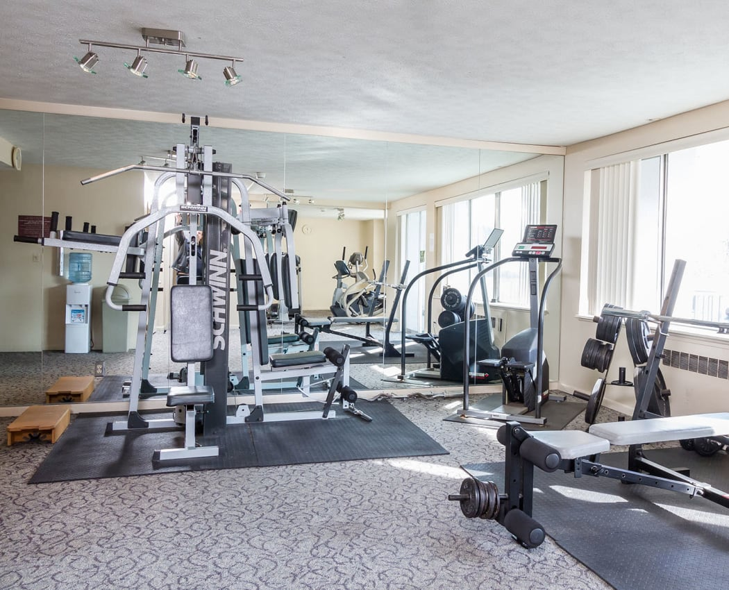 Fully equipped fitness center at Oak Hill Terrace in Rochester, New York