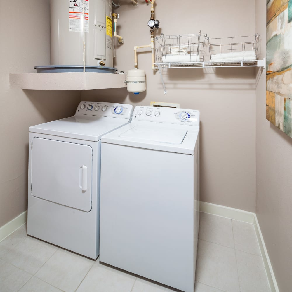 Spacious laundry room with washer and dryer at Lakefront Villas in Houston, Texas