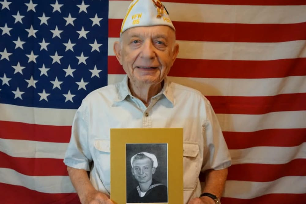 Proud veteran celebrating Veteran's Day at Campus Commons Senior Living in Sacramento, California