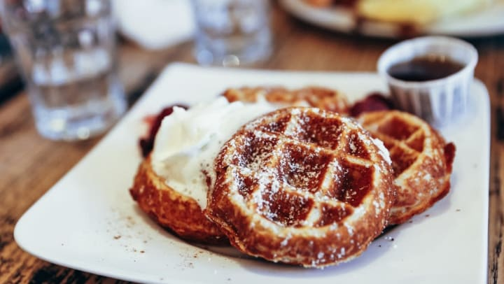 Plate of waffles at a breakfast spot near Olympus Las Colinas in Irving, Texas