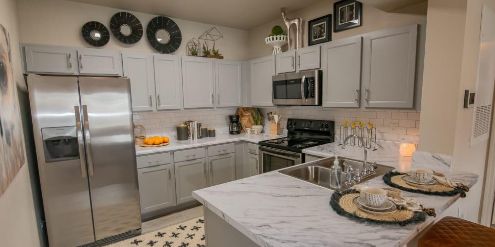 Stainless-steel kitchen appliances at 97@ North Oak in Kansas City, Missouri