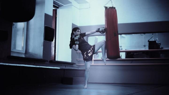 Woman practicing muay thai at Olympus Katy Ranch in Katy,  Texas