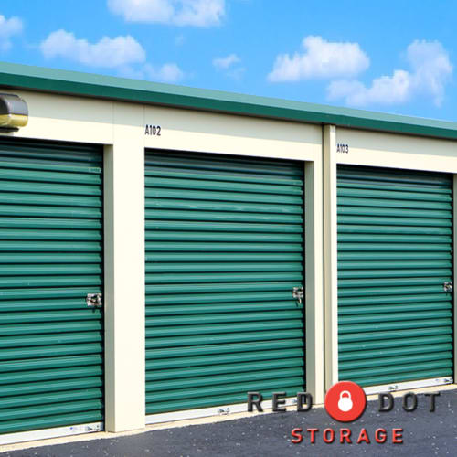 Storage units with green doors at Red Dot Storage in Machesney Park, Illinois