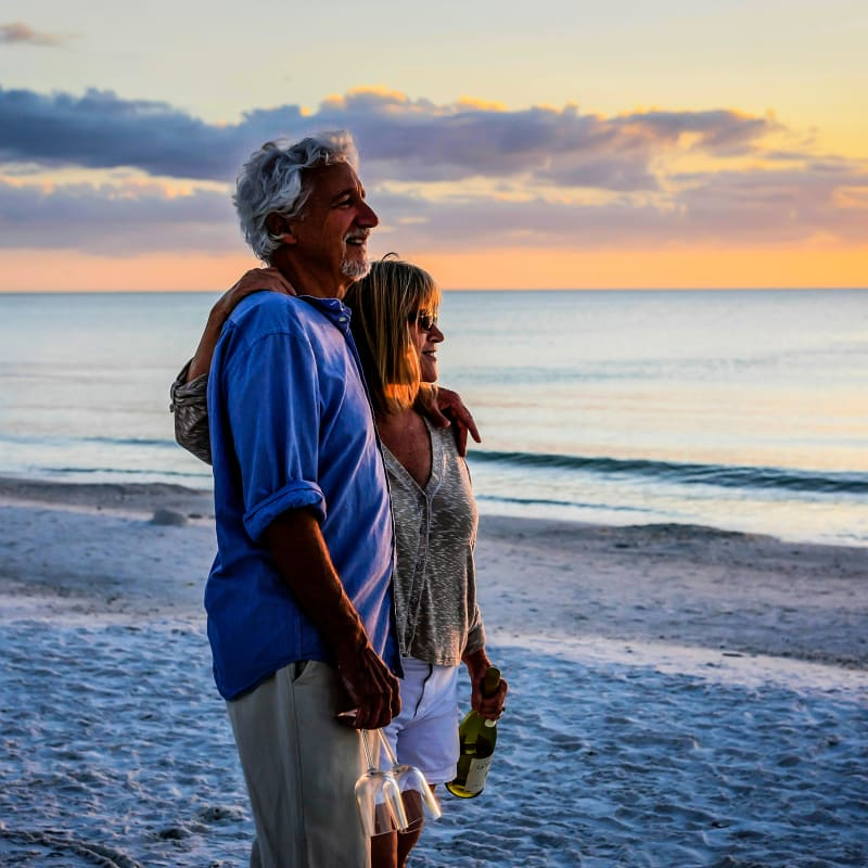 Resident couple enjoying the sunset on the beach at Portside Ventura Harbor in Ventura, California