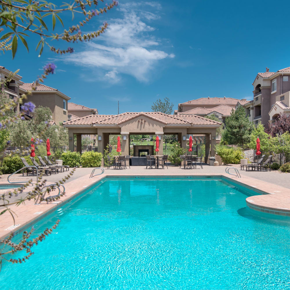 Gorgeous resort-style swimming pool on another sunny day at Broadstone Towne Center in Albuquerque, New Mexico