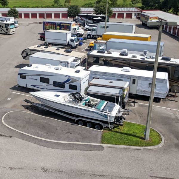 RVs, boats, trucks, and trailers parked at StorQuest Self Storage in Temecula, California
