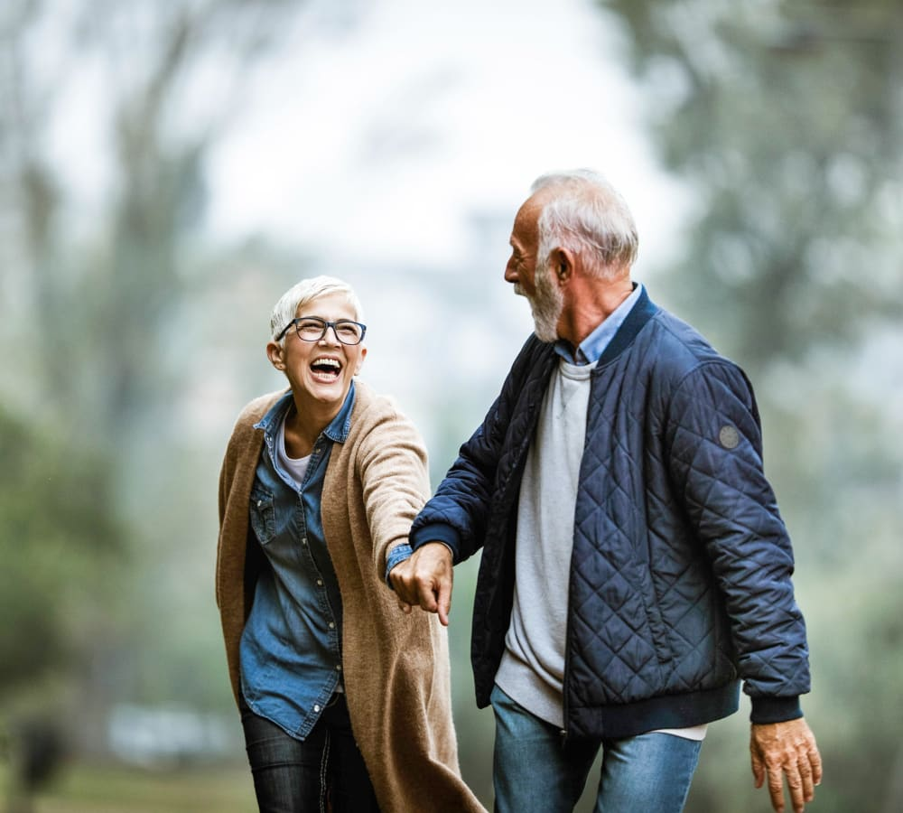 A resident couple taking a walk at Bridgeport Place Assisted Living in University Place, Washington.