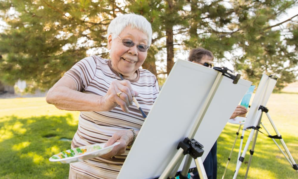 A resident enjoying painting at Touchmark on Saddle Drive in Helena, Montana