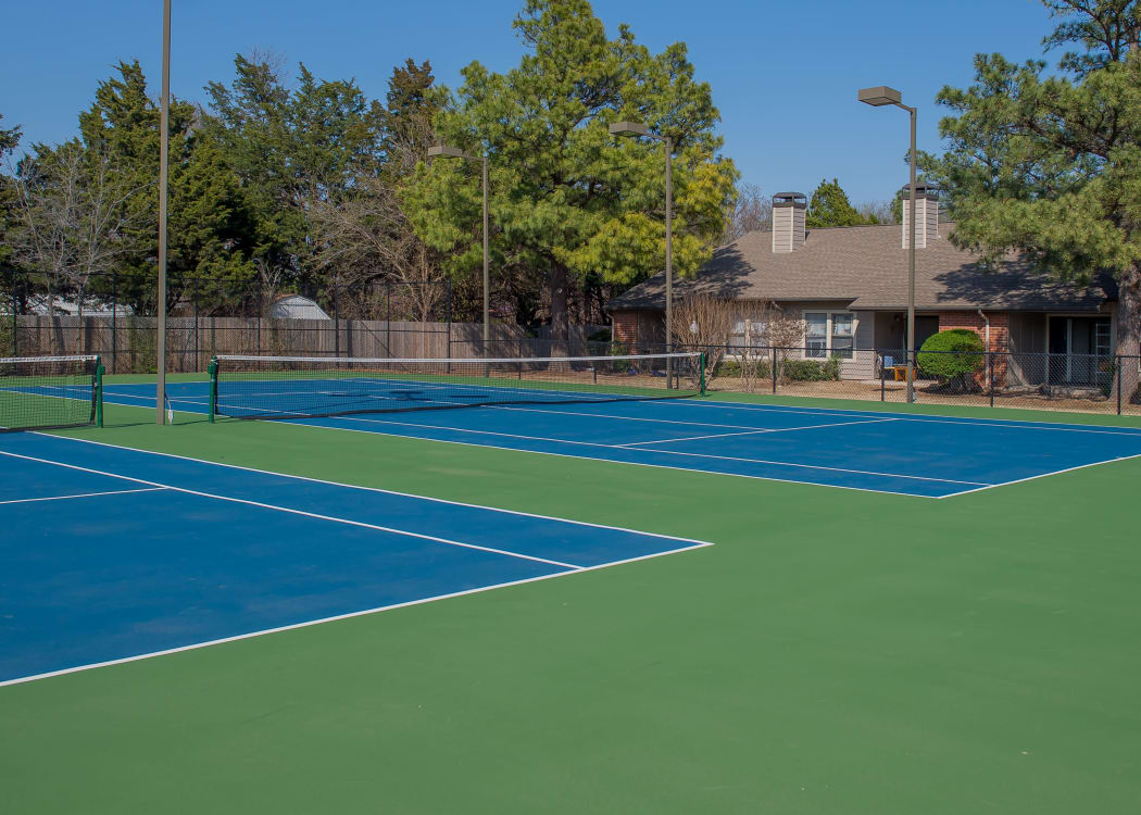 Tennis courts with lights at Woodscape Apartments in Oklahoma City, Oklahoma