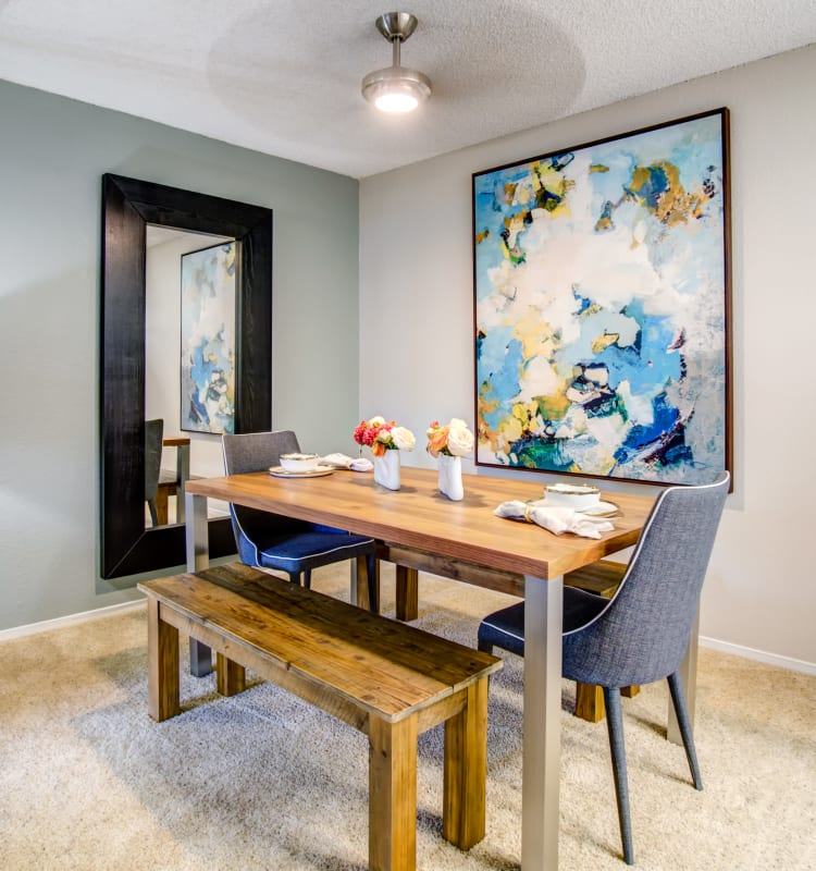 Well-decorated dining area with a ceiling fan in a model home at Vue Fremont in Fremont, California